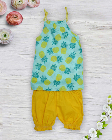 Pineapple print pastel green top with yellow shorts