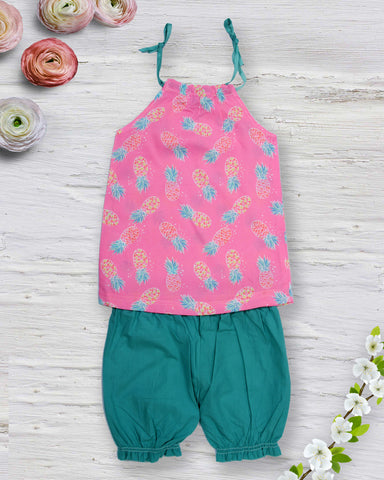 Pineapple print pink top with green shorts