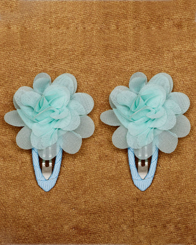 A pair of floral tic-tac hair clips - Light blue