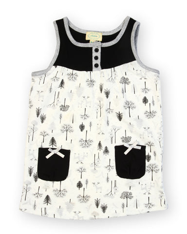 White base trees black pocket dress