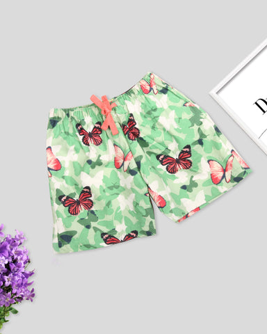 Green base butterfly printed girls woven shorts
