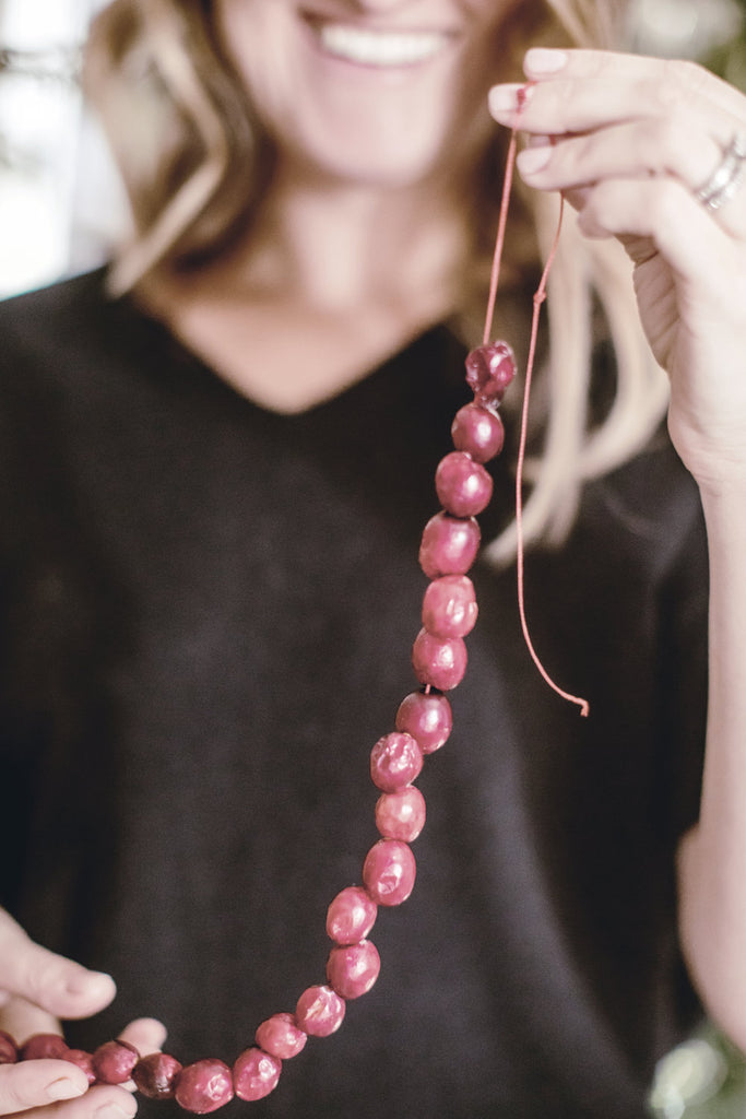 Stringing a Traditional Cranberry Garland.