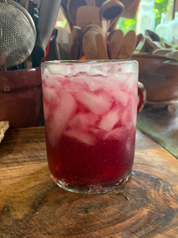 Blueberry Mint Shrub Cocktail in a tumbler glass