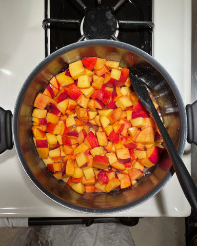 Peaches in a pot on a stove