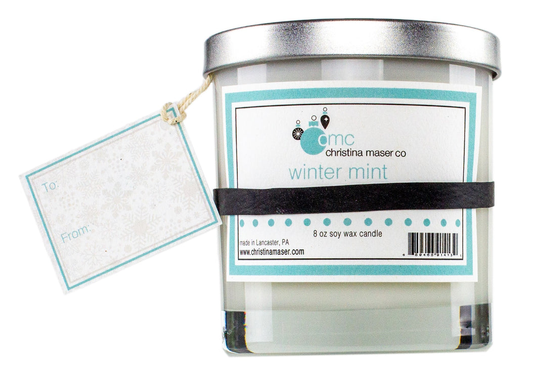 Winter mint holiday special edition soy wax candle. 8 oz clear glass tumbler with silver metal lid. includes blank gift tag. great for holiday shopping and holiday gifting.