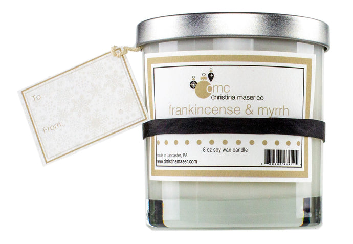 Frankincense & myrrh holiday special edition soy wax candle. 8 oz clear glass tumbler with silver metal lid. includes blank gift tag. great for holiday shopping and holiday gifting.