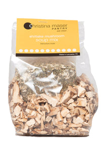 Shiitake mushroom dry soup mix. Close up of dried mushrooms and spices in clear cello bag with orange label.