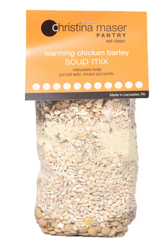 Photo of Chicken Barley dry Soup Mix. Close-up of grains and spices in a clear cello bag with an orange label.