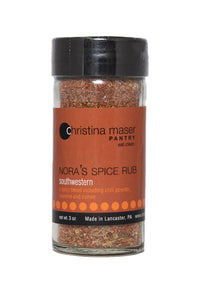Southwestern Spice rub in clear glass jar with black lid and rich brown label with orange accents.