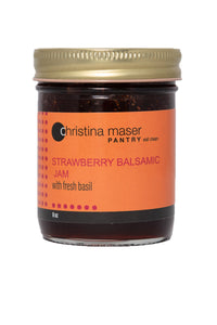 Strawberry Balsamic Jam in clear glass jar with orange label. Label has pinkish-red accents.