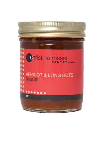 Photo of Apricot and Long Hots Pepper Jam in a glass mason jar with a red wraparound label.