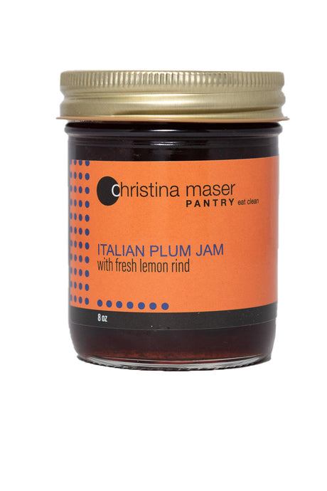 Italian Plum Jam in a clear glass mason jar with orange wraparound label with indigo colored accents. Made with local plums and organic cane sugar in small batches.