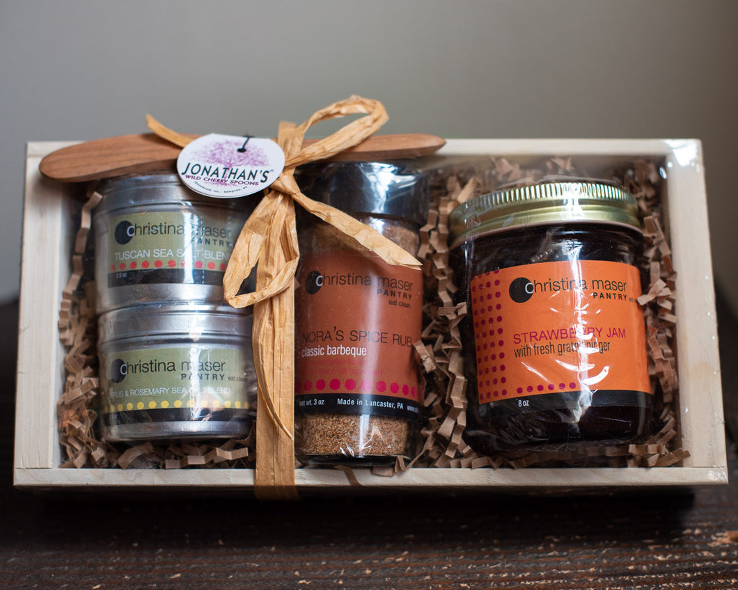 Christina Maser gift set in pale wood crate. Features two salt blends, one spice rub, and strawberry jam. Includes handmade wild cherry spreader by Jonathan's Spoons.