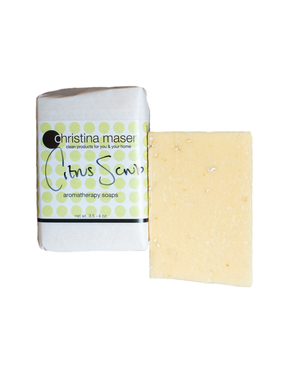 Citrus Scrub vegan bar soap by Christina Maser Co. Soap is rectangular and natural colored. Wrapped in white paper with a wraparound label with lime green dot accents.