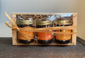 Gift set contains apple conserve jar, cranberry conserve jar, and sour cherry jam in a pale wooden crate. Great for Father's Day.