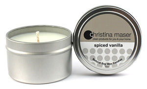 Spiced vanilla soy wax candle in silver metal tin with lid featuring beige label.
