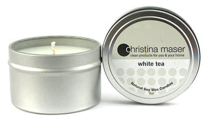 White tea soy wax candle in silver metal tin with lid featuring beige label.