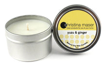 Load image into Gallery viewer, Yuzu and ginger soy wax candle in silver metal tin with lid featuring yellow label.
