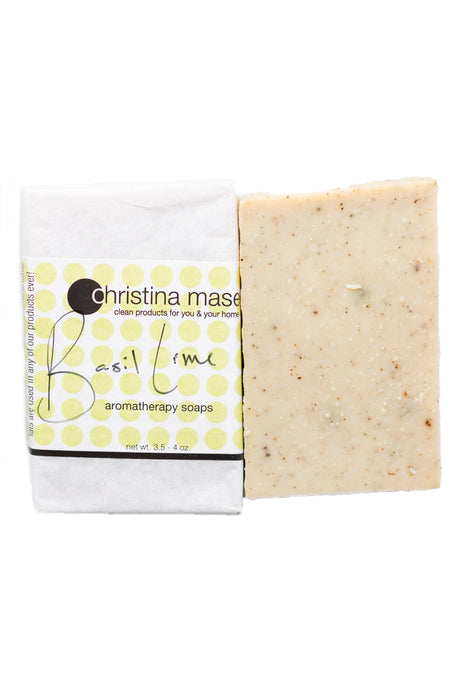 Photo of Basil Lime vegan bar soap. Wrapped bar in white paper with light green polka dots.