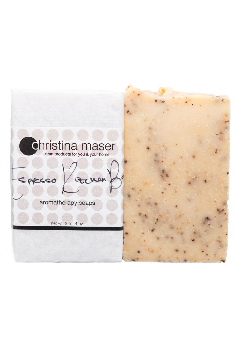 Espresso Kitchen Bar vegan bar soap. All natural hand poured soap. Soap is natural colored with pops of ground espresso. Bar is wrapped in white paper with wraparound label with beige/brown dot accents.
