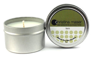 Fern soy wax candle in silver metal tin. Tin has a lid that features a forest green label.