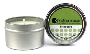 Fir Needle soy wax candle in silver metal tin. Tin has a lid and feature a forest green label.