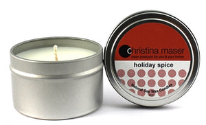 Holiday Spice soy wax candle in silver metal tin with lid and red label.