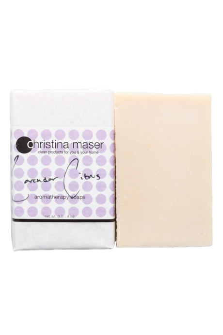 Lavender citrus vegan bar soap. Soap is natural colored and wrapped in white paper. Label has light purple dot accents and black text.