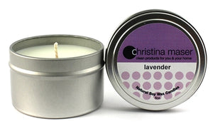 Lavender soy wax candle in silver metal tin with lid and purple label.