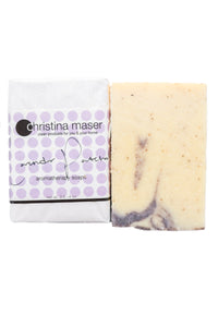 Lavender Patchouli vegan bar soap. Rectangular soap wrapped in white paper. Label has purple dot accents.