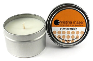 Pure Pumpkin soy wax candle in silver metal tin with lid featuring orange label.