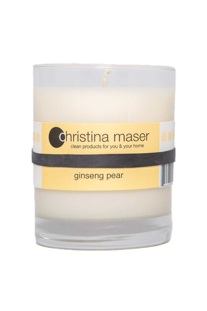 Ginseng Pear soy wax candle in glass tumbler. Tumbler is clear glass with light yellow label.
