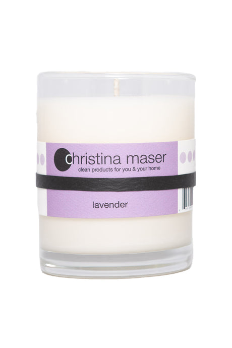 Lavender soy wax candle in glass tumbler. Tumbler is clear glass with lavender colored label. Reuse or recycle when finished.