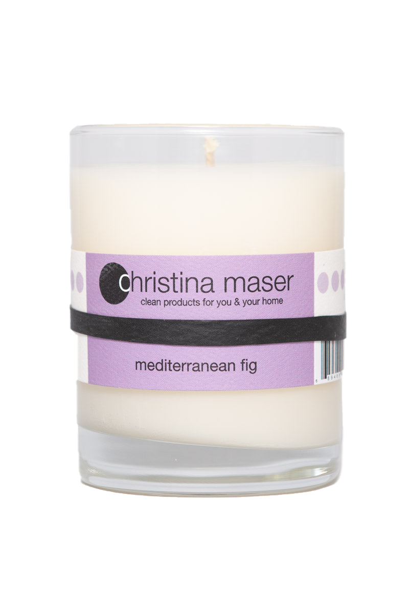 Mediterranean Fig soy wax candle in glass tumbler. Tumbler is clear glass with purple label.