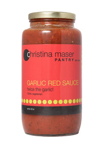 Garlic Red Sauce for pasta or pizza. Large clear glass jar with red label with green accents.