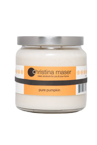 Pure pumpkin soy wax candle in clear glass jar with silver metal lid and orange label.