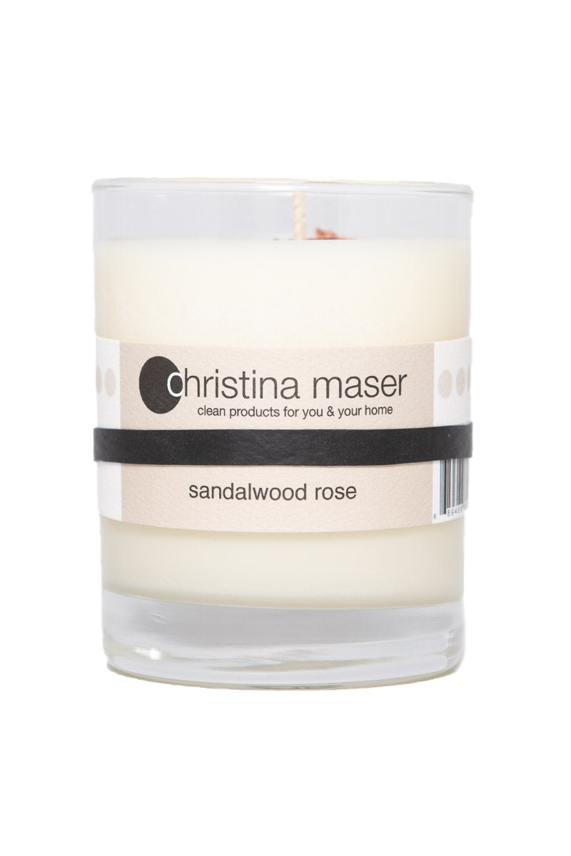 Sandalwood rose soy wax candle in clear glass tumbler with beige label. Recycle or reuse when finished.