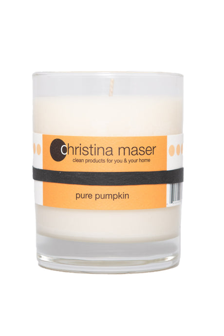 Pure pumpkin limited edition soy wax candle in clear glass tumbler with orange label.