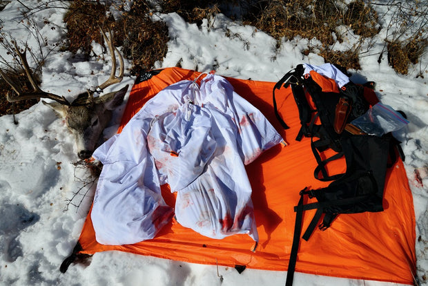 The Hunters Tarp Protecting Caribou Gear Game Bags