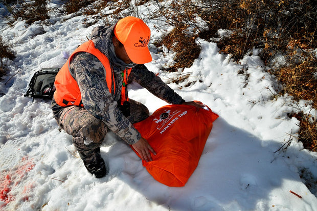 The Hunters Tarp Covering Caribou Gear Game Bags