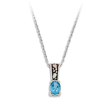 Sterling Silver Black Hills Gold Antiqued Blue Topaz Pendant - Jewelry