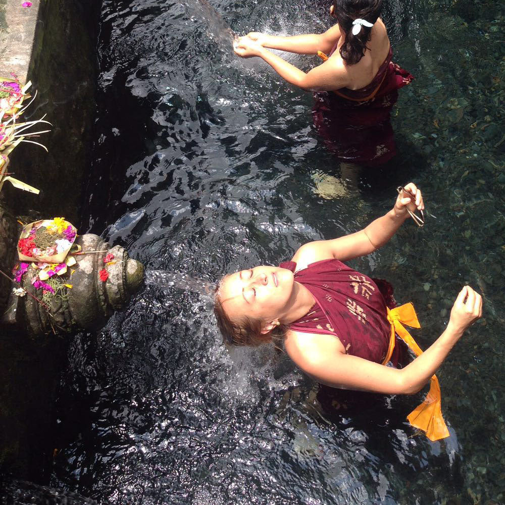 Image of Freya under a fall in Indonesia where Freya Rose shoes are ethically sourced