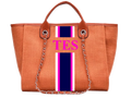 An orange canvas tote bag designed by MVFURS