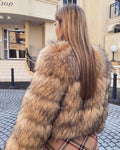 "A woman wearing a beautiful faux raccoon fur. This design is called ""Elisa"" designed by MVFURS."