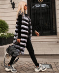 "A woman wearing a Genuine chinchilla fur vest. Item called ""Annete"" designed by MVFURS"