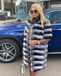 "A woman wearing a long genuine chinchilla coat called ""Nikita"" designed by MVFURS."