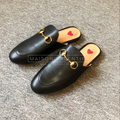"Woman black leather sliders called ""Vegas"" designed by MVFURS."