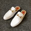 "Woman white leather sliders called ""Vegas"" designed by MVFURS."