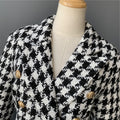 "A Houndstooth coat called ""Dana"" designed by MVFURS."
