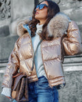 "A woman wearing a gold down fur puffer parka called ""Marina"" designed by MVFURS."